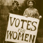 Annie Kenney and Christabel Pankhurst holding votes for women banner
